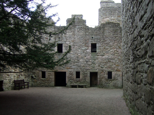 Courtyard of Craigmillar Castle, a grand but ruinous castle with a large tower and two courtyards, held by the Prestons and the Gilmours, and associated with Mary Queen of Scots, in the Craigmillar area of Edinburgh.