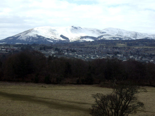 Snow covered Pentland Hills from Craigmillar Castle, a grand but ruinous castle with a large tower and two courtyards, held by the Prestons and the Gilmours, and associated with Mary Queen of Scots, in the Craigmillar area of Edinburgh.