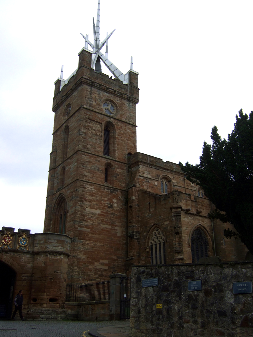St Michael's Parish Church, by Linlithgow Palace, a large, ruinous and impressive royal residence of the monarchs of Scotland and birthplace of Mary, Queen of Scots, in a scenic location in a park with a pond in the historic burgh of Linlithgow.