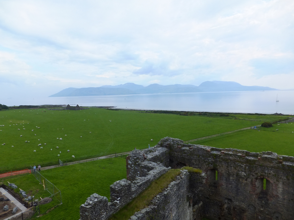 View of Arran from the battlements of Skipness Castle, a large and scenic tower and courtyard overlooking Kilbrandon Sound and Arran, long held by the Campbells and near Tarbert in Kintyre on the west coast of Scotland.