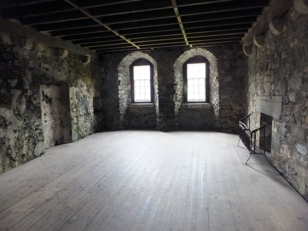 Chamber in the gatehouse tower of Dunstaffnage Castle, an impressive but grim old ruinous walled castle, long held by the Campbells, with later tower and atmospheric chapel in a wooded spot near Oban in Argyll.