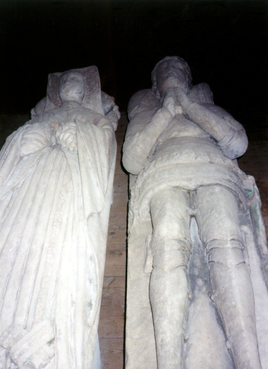 Stone effigies of Sir William Borthwick and Beatrice Sinclair in Borthwick Church, near Borthwick Castle, a lofty and magnificent tower house in a quiet scenic location, built in the 15th century by the Borthwick family and now an exclusive hotel, located