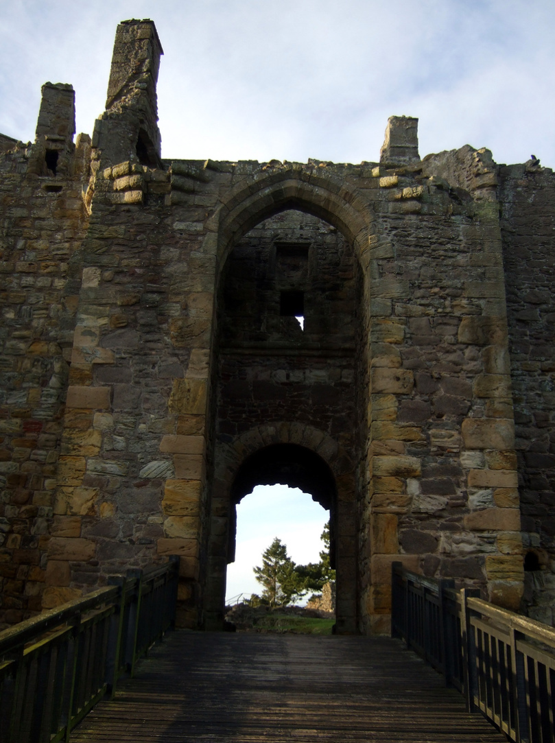 Gateway across the bridge of Dirleton Castle, a magnificent medieval ruined castle, near North Berwick in East Lothian
