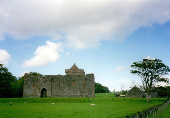 Skipness Castle, a large and scenic tower and courtyard overlooking Kilbrandon Sound and Arran, long held by the Campbells and near Tarbert in Kintyre on the west coast of Scotland.