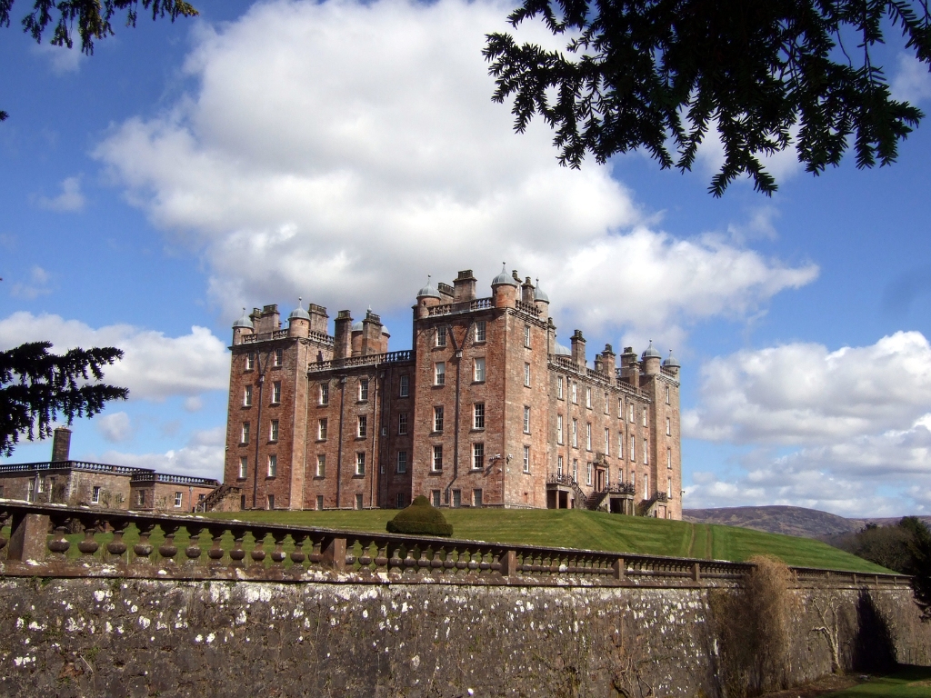 Drumlanrig Castle, a magnificent old baronial mansion in expansive lovely parkland and gardens, held by the Douglases then by the Scott Dukes of Buccleuch, near Thornhill in Dumfries and Galloway.