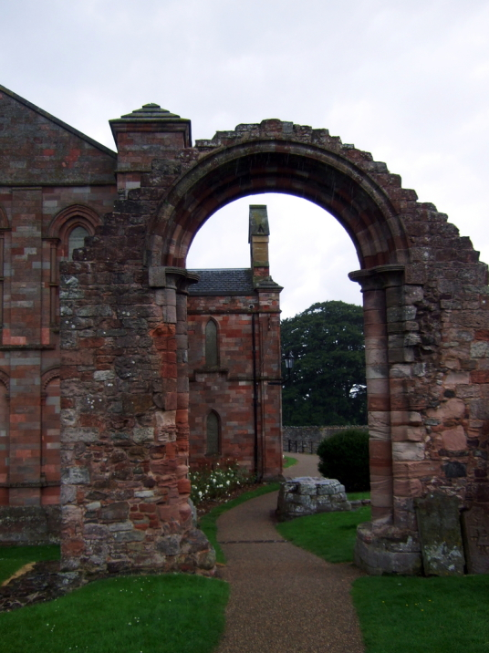 Transept arch of Coldingham Priory, now used as the parish church, in the interesting graveyard with many old memorials in the scenic village of Coldingham