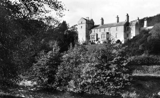 Branxholme Castle, a fine old castle and mansion, long held by the Scotts of Buccleuch, in a pretty wooded spot near Hawick in the Borders of Scotland.