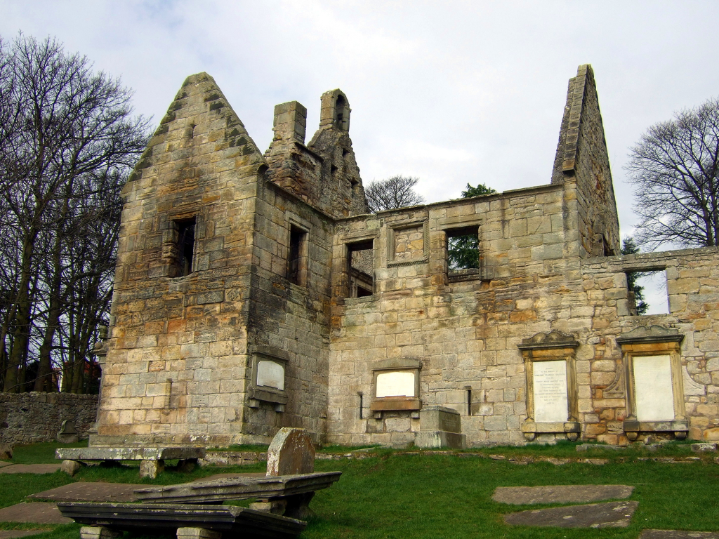 Laird's quarters, St Bridget's Kirk at Dalgety is a fascinating old church with a domestic block at one end, built by the Setons, in a pretty wooded spot by the sea, near the new town of Dalgety Bay in Fife in central Scotland.