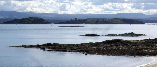 View from Aberdour of Inchcolm Abbey, a well-preserved and picturesque complex of buildings on an atmospheric island off the cost of Fife in the Firth of Forth,
