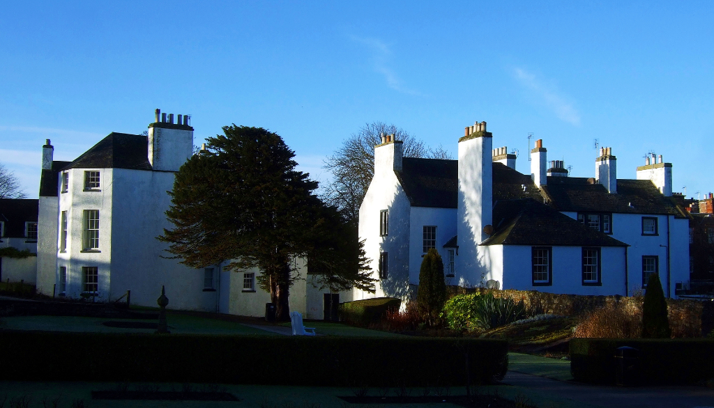 The Lodge, North Berwick, an attractive grouping of whitewashed buildings in expansive gardens and public parkland, long held by the Dalrymples and in the popular seaside town of North Berwick in East Lothian in southeast Scotland.