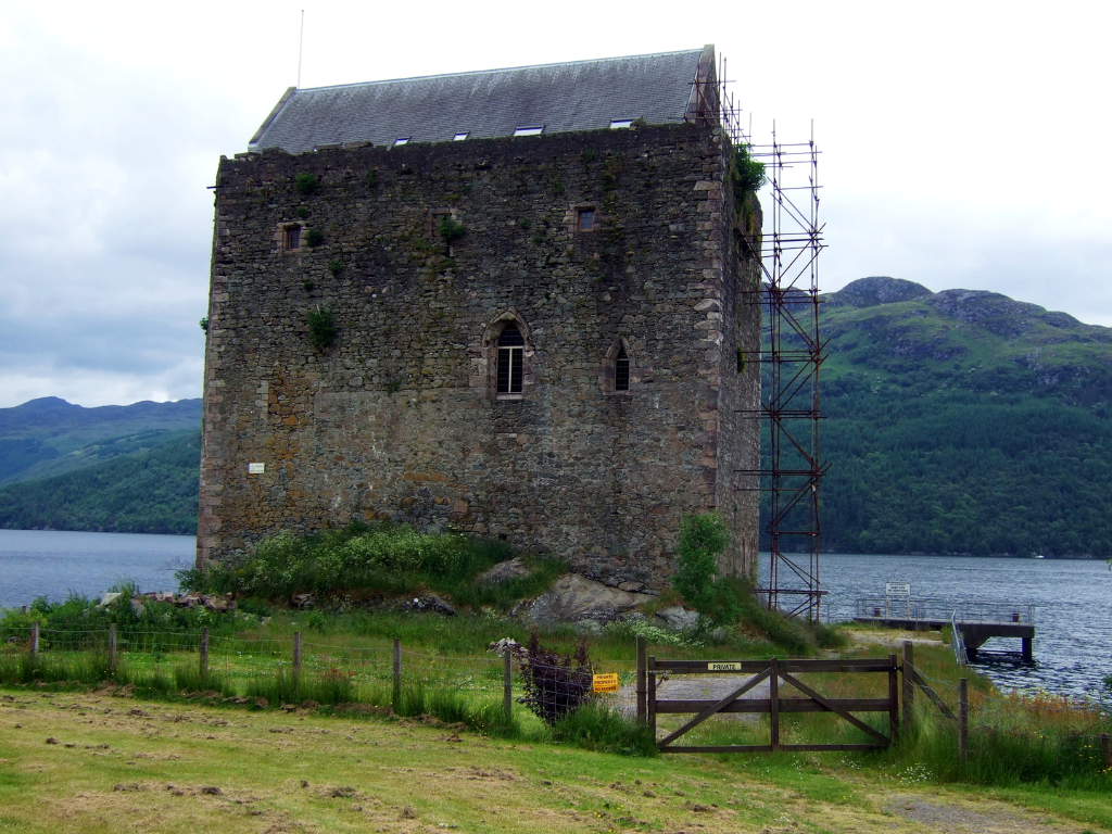 Carrick Castle, an impressive old tower house in a pretty spot on the banks of Loch Goil, long held by the Campbells and near the village of Lochgoilhead in Argyll in western Scotland.
