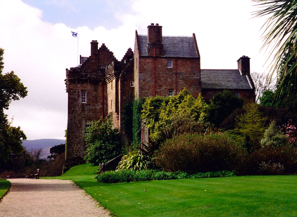 Brodick Castle, a large and attractive old stronghold and later mansion, standing in a prominent spot in colourful gardens and grounds near Brodick on the island of Arran in western Scotland, and held by the powerful Hamiltons.