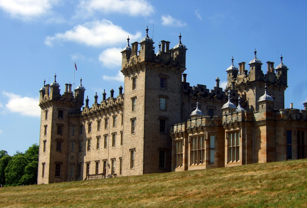 Floors Castle is the massive and magnificent mansion of the Kerr Dukes of Roxburghe, with a rich and magnificent interior, set in rolling grounds with a colourful walled garden, near Kelso in the Broders in southern Scotland.