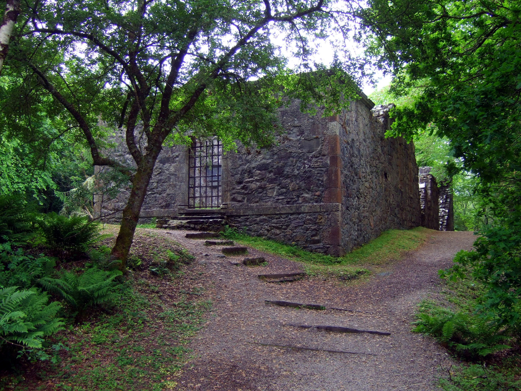 Chapel of Dunstaffnage Castle, an impressive but grim old ruinous walled castle, long held by the Campbells, with later tower and atmospheric chapel in a wooded spot near Oban in Argyll.