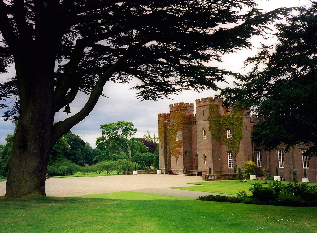 Scone Palace, a fabulous castellated mansion house with a magnificent interior and wooded landscaped grounds by the River Tay, long held by the Murray Earls of Mansfield and near Perth in central Scotland.