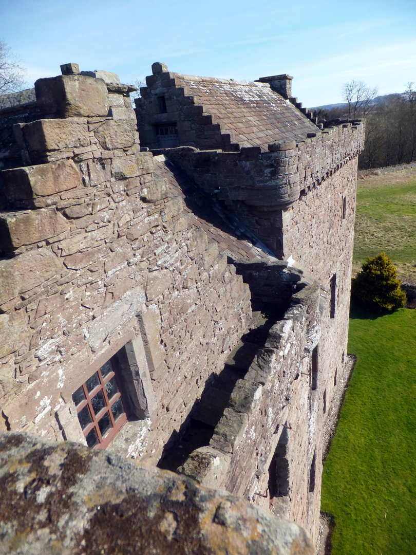 Battlements of Huntingtower Castle is a handsome and atmospheric old castle and mansion near Perth in central Scotland, once home to the Ruthven Earls of Gowrie, but the earl and his brother were slain by James VI and the castle and earldom seized, eventu
