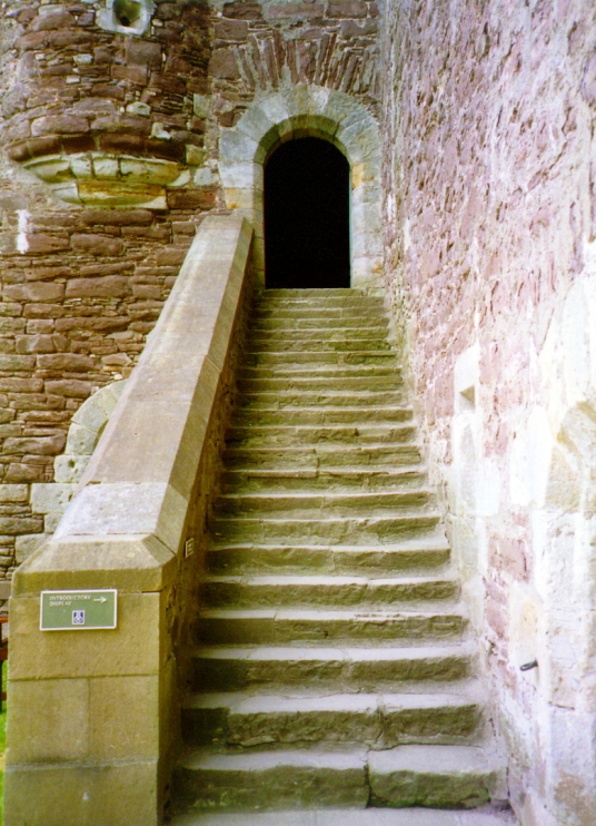 View of a stair to the kitchen and great hall in the courtyard of Doune Castle, a magnificent medieval castle in a pretty spot by the River Teith, built by Robert Stewart, Duke of Albany, near Doune in Stirlingshire.