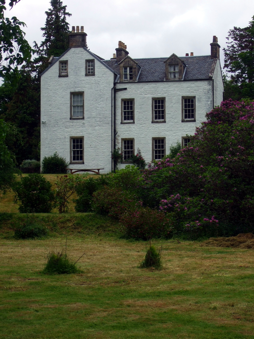 Dunollie House, near Dunollie Castle, an impressive ruinous tower on a prominent wooded spot above the later Dunollie House, long held by the MacDougalls, now with a museum, and near the seaside town of Oban in Argyll on the west coast of Scotland.