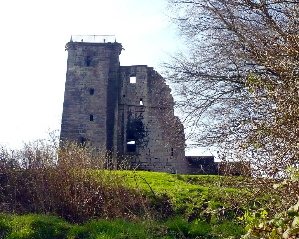 Crookston Castle is an unusually planned, tall and ruinous old tower in a quiet spot with fine views, held by the Stewarts of Lennox and once besieged by the great siege cannon Mons Meg, lying to the south of Glasgow in central Scotland.