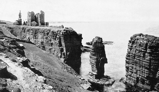 Girnigoe Castle, also known as Castle Sinclair, is a fabulous,  impressive and once splendid ruinous old stronghold on cliffs above the sea, near Wick in Caithness in the far north of Scotland and long the seat of the powerful Sinclairs.