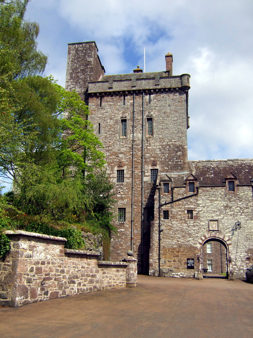 Drummond Castle , an impressive old castle and later mansion with spectacular formal gardens, long held by the Drummond family and near Muthil in Perthshire.