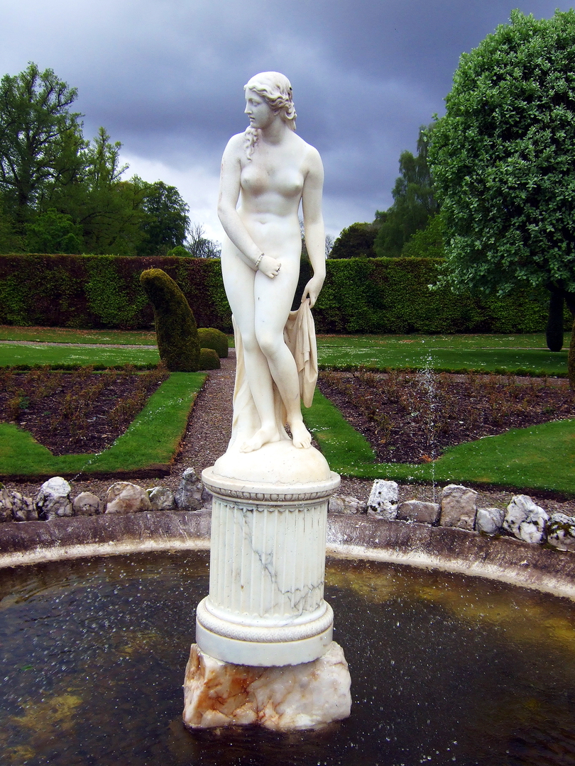 Statue in the beautiful gardens of Drummond Castle , an impressive old castle and later mansion with spectacular formal gardens, long held by the Drummond family and near Muthil in Perthshire.