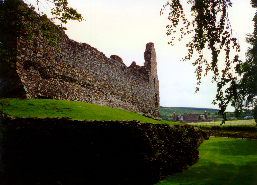 Balvenie Castle is a large ruinous courtyard castle with ranges of buildings enclosed by a strong curtain wall and ditch, in a pleasant and peaceful spot near Dufftown in Moray in northern Scotland.