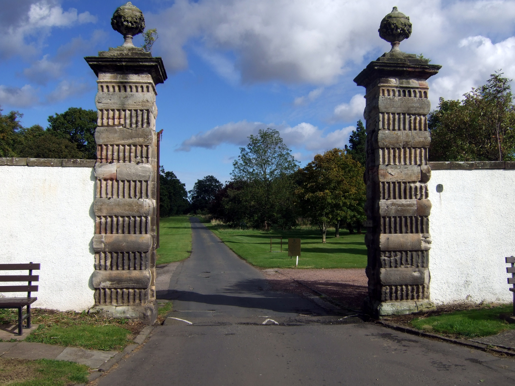 Gateway of Amisfield House, Haddington, once owned by the Earls of Wemyss of Gosford House, the large and magnificent mansion of the Earls of Wemyss, set in fantastic landscaped grounds with pleasure grounds, woodland and ponds, standing near Longniddry i