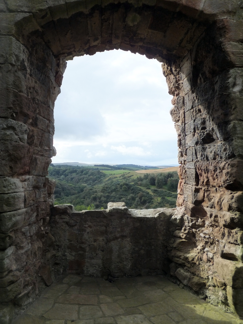 View from a window of the great hall of Crichton Castle, a fabulous ruined medieval castle in a pretty spot above the River Tyne, held by the Crichtons, Hepburn and Stewart Earls of Bothwell, near to Pathhead and Edinburgh