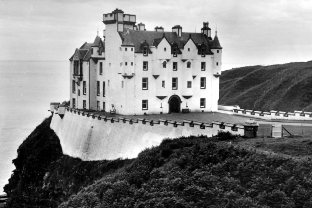 Dunbeath Castle, a handsome whitewashed castle on a spectacular cliff top location, in Caithness