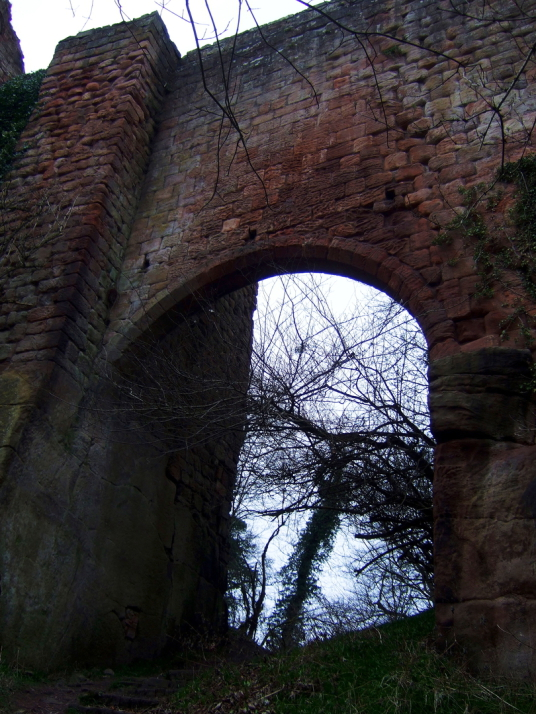 Entrance over a bridge to Roslin Castle, an impressive, partly ruinous old stronghold on a rock above the River Esk, long held by the Sinlcairs and near the beautiful and intricately carved Rosslyn Chapel