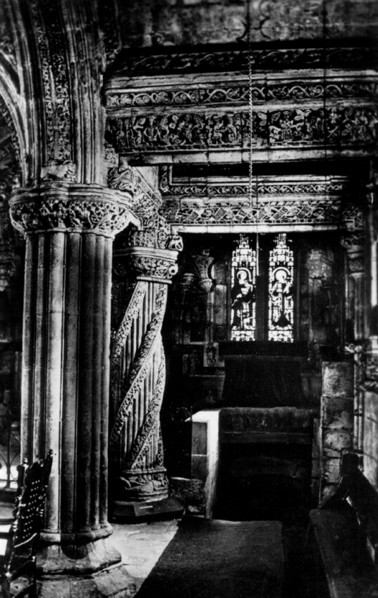 Interior showing pillars and stairs to crypt of Rosslyn Chapel, near Roslin Castle, an impressive, partly ruinous old stronghold on a rock above the River Esk, long held by the Sinlcairs and near the beautiful and intricately carved Rosslyn Chapel