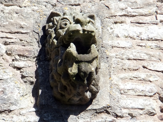 View of gargoyle on wall of great hall of Doune Castle, a magnificent medieval castle in a pretty spot by the River Teith, built by Robert Stewart, Duke of Albany, near Doune in Stirlingshire.