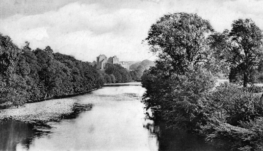 View of the River Teith and Doune Castle, a magnificent medieval castle in a pretty spot by the River Teith, built by Robert Stewart, Duke of Albany, near Doune in Stirlingshire.
