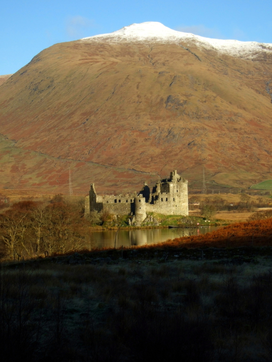 View of Kilchurn Castle, one of the best castles of the 4,100 castles, towers, stately homes, historic houses and family lands featured in The Castles of Scotland by Martin Coventry and published by Scottish publisher Goblinshead