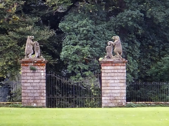View of Bear Gates of Traquair House, a fabulous homely old castle and house, long a property of the Stewarts and associated with Mary, Queen of Scots, in lovely grounds near Innerleithen in the Borders of Scotland.