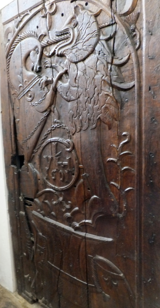 View of carved door in Traquair House, a fabulous homely old castle and house, long a property of the Stewarts and associated with Mary, Queen of Scots, in lovely grounds near Innerleithen in the Borders of Scotland.