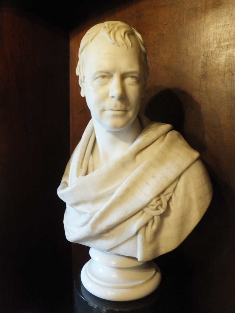 Bust of Sir Walter Scott in the library of Abbotsford House, the home of Sir Walter Scott, the famous author, and stands in fine wooded grounds and gardens by the River Tweed, near Tweedbank, Melrose and Galashiels in the Borders of Scotland.