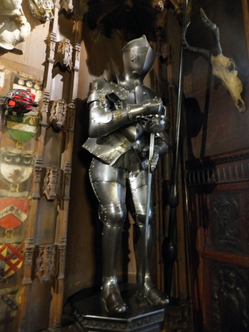 Suit of armour in the entrance hall of Abbotsford House, the home of Sir Walter Scott, the famous author, and stands in fine wooded grounds and gardens by the River Tweed, near Tweedbank, Melrose and Galashiels in the Borders of Scotland.