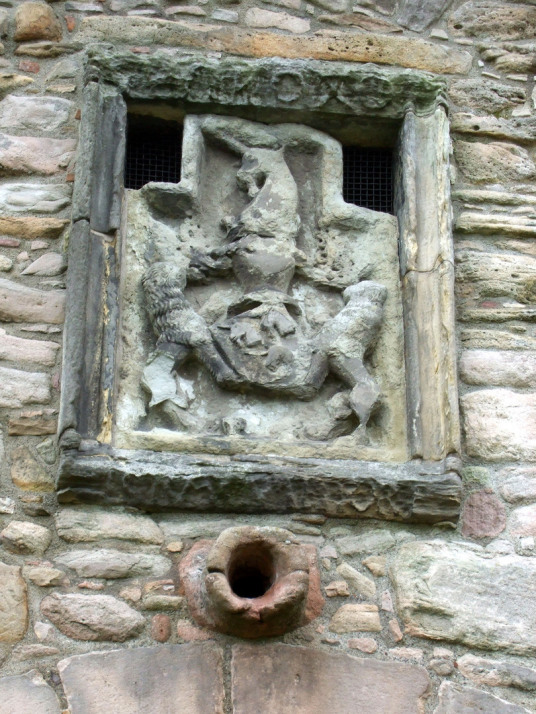 Heraldic panel at Craigmillar Castle, a grand but ruinous castle with a large tower and two courtyards, held by the Prestons and the Gilmours, and associated with Mary Queen of Scots, in the Craigmillar area of Edinburgh.