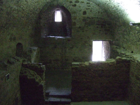 Vaulted basement of Craigmillar Castle, a grand but ruinous castle with a large tower and two courtyards, held by the Prestons and the Gilmours, and associated with Mary Queen of Scots, in the Craigmillar area of Edinburgh.