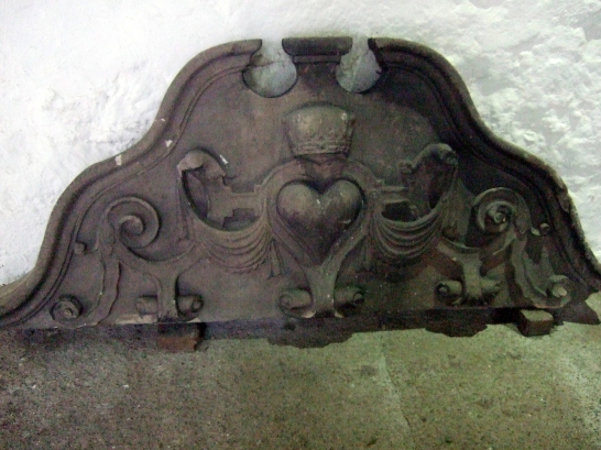 Carved Douglas coat of arms at Aberdour Castle, a scenic old stronghold castle with gardens and orchard of the Douglas Earls of Morton, in the pretty village of Aberdour in Fife.