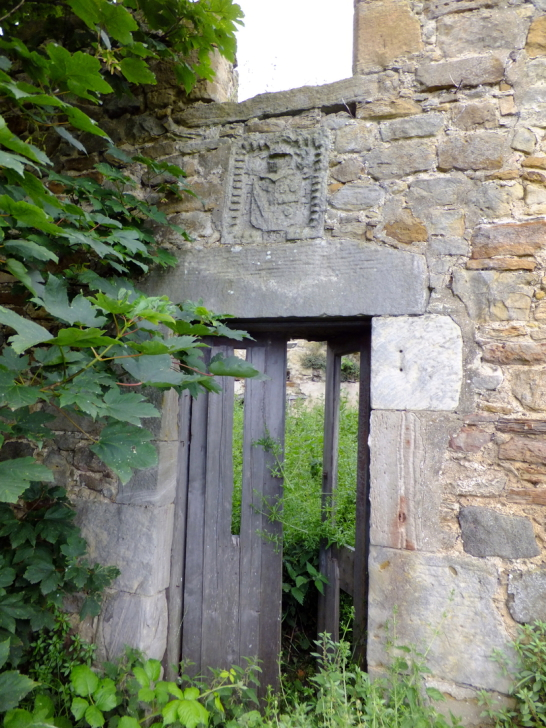 Gateway and heraldic panel of Saltcoats Castle, a scenic, ruinous and overgrown old castle of the Livingstone family, near the pretty village of Gullane in East Lothian.