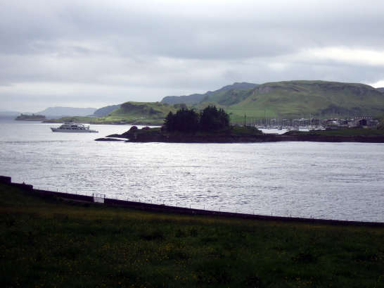 Kerrera from Dunollie, near Dunollie Castle, an impressive ruinous tower on a prominent wooded spot above the later Dunollie House, long held by the MacDougalls, now with a museum, and near the seaside town of Oban in Argyll on the west coast of Scotland.