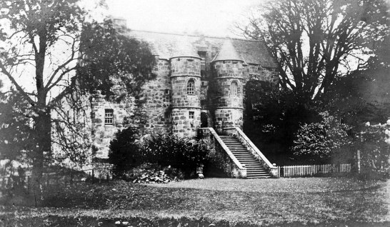 Rowallan Castle, an impressive old stronghold with a drum-towered entrance of the Mure family in landscaped grounds near Kilmarnock in Ayrshire.