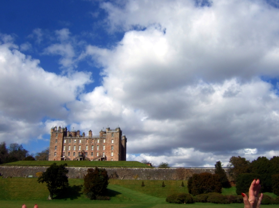 Drumlanrig Castle, an impressive baronial mansion and castle in expansive landscaped parkland and gardens of the Douglases and then the Scott Dukes of Queensberry with fingers