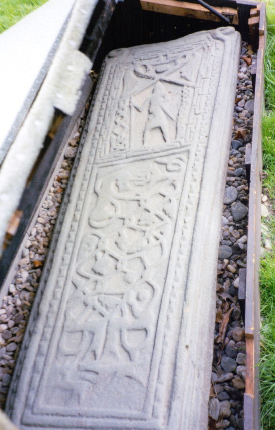 Carved graveslab, St Brendan's Chapel or Kilbrannon, near Skipness Castle, a large and scenic tower and courtyard overlooking Kilbrandon Sound and Arran, long held by the Campbells and near Tarbert in Kintyre on the west coast of Scotland.