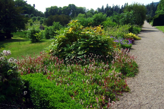 Extensive and colourful gardens of Blair Castle, the magnificent castle with a sumptuous interior of the Murray Dukes of Atholl, set in lovely gardens and grounds in a mountainous location, at Blair Atholl near Pitlochry in Perthshire.