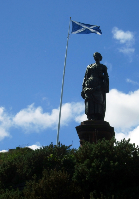 Highland Mary's statue (Mary Campbell associated with Robert Burns) near Dunoon Castle stood on a mound but little remains of the royal castle except some walling, by the sea in the grounds of the Castle House Museum in Dunoon on Cowal in Argyll in wester