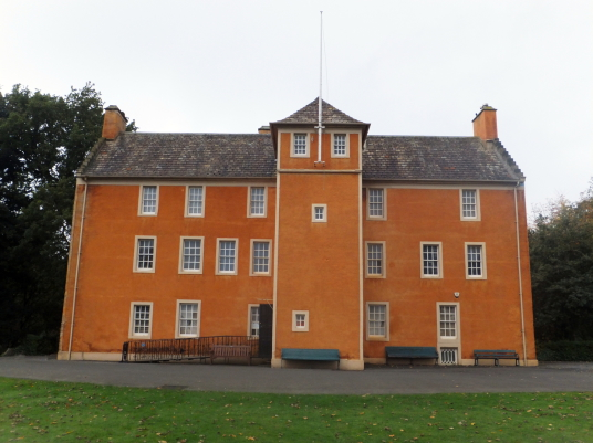 Pittencrieff House, an imposing orange-washed old house, standing in the picturesque Pittencrieff Park in Dunfermline in Fife and associated with Andrew Carnegie.
